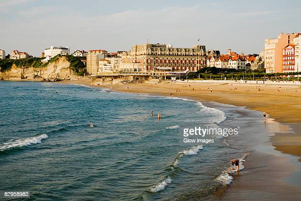 waves on the beach, grande plage, hotel du palais, biarritz, france - biarritz stock pictures, royalty-free photos & images