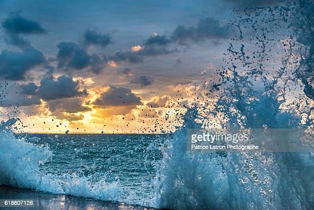 Waves on the sea wall of St Malo during big tides at sunset.