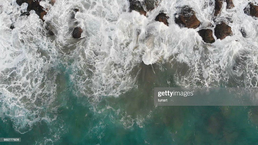 Waves Over Rocky Sea : Stock Photo