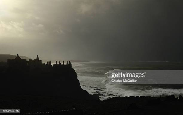 Waves roll in under Dunluce Castle ruins on December 10 2014 in Portrush Northern Ireland High winds and large waves hit the North West Coast of the...