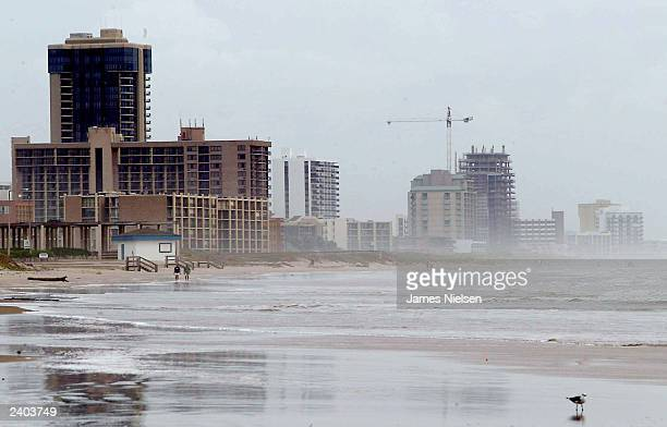 Waves roll up the beach front of South Padre Island after tropical storm Erika made landfall near the TexasMexico border early August 16 2003 on...