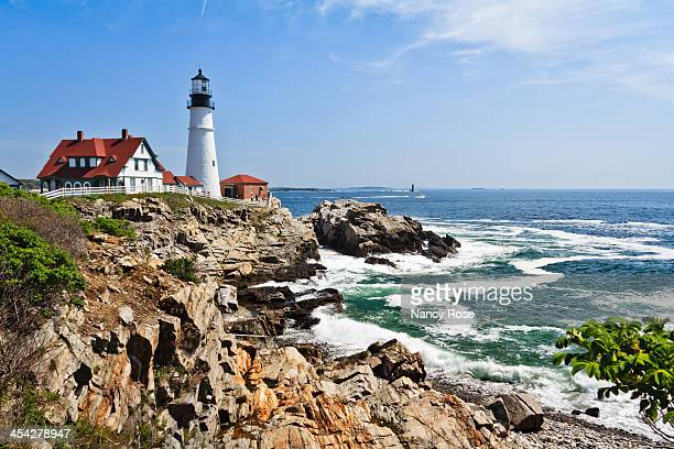 CONTENT] Waves rolling in at Portland Head Lighthouse at Cape Elizabeth Maine on a warm sunny spring morning