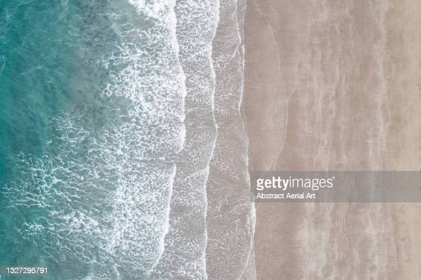 waves rolling onto a beach seen from above, isle of wight, united kingdom - isle of wight stock pictures, royalty-free photos & images