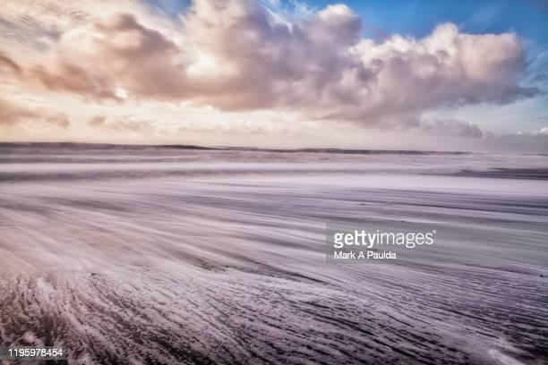 waves rushing in on an icelandic beach - retreating ストックフォトと画像