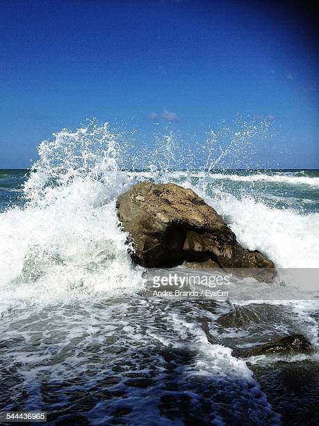 Waves Rushing On Rock Formation In Sea