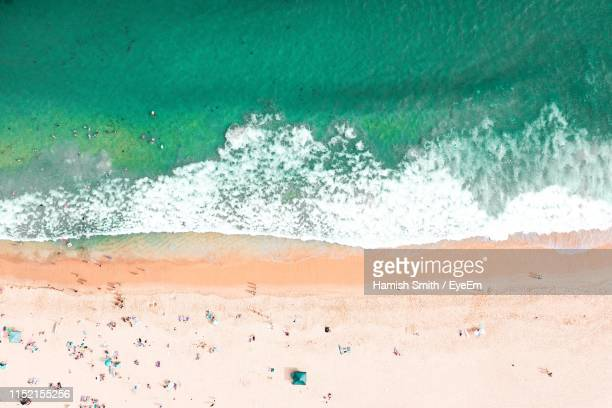 waves rushing towards shore - copacabana beach stock pictures, royalty-free photos & images