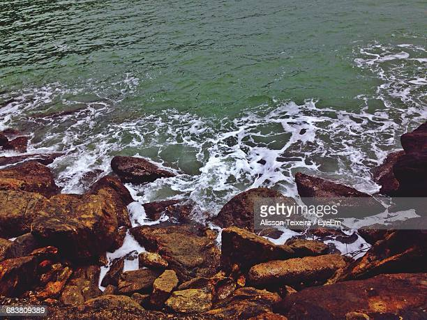 waves rushing towards shore - alisson stock pictures, royalty-free photos & images