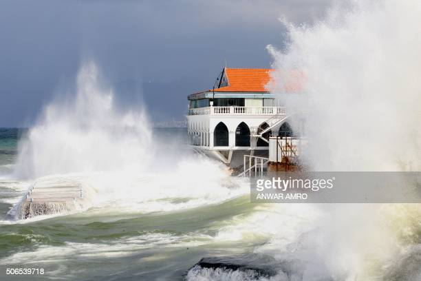 TOPSHOT Waves smash against a restaurant building at Beirut's seaside promenade as heavy winds and rain whipped across Lebanon on January 24 2016 /...