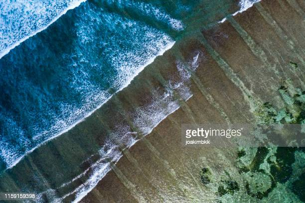 waves splashing along the coastline of bali - hd format stock pictures, royalty-free photos & images