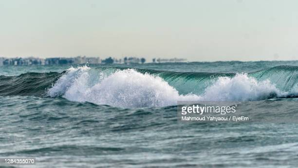 waves splashing in sea against clear sky - tunisia stock pictures, royalty-free photos & images
