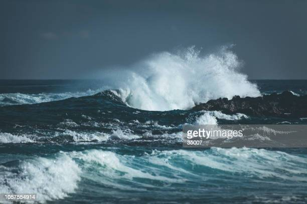 waves splashing indian ocean - storm stock pictures, royalty-free photos & images