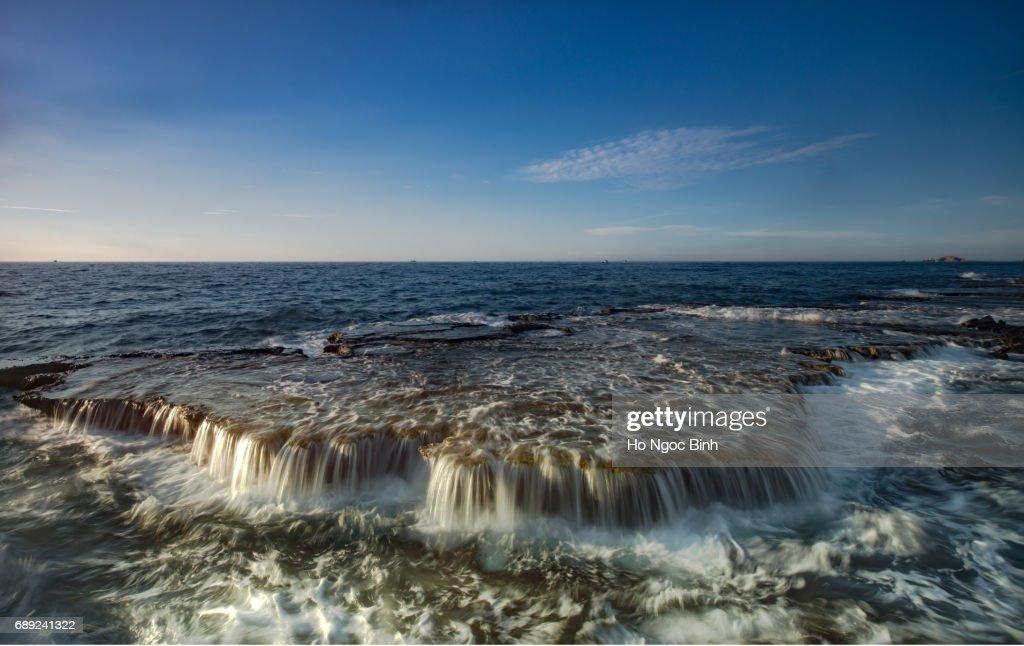 Waves Splashing On Rocks At Beach : Stock Photo