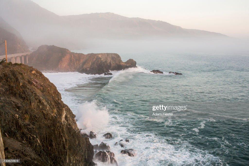 Waves splashing on rocks at cliffs : Stock Photo