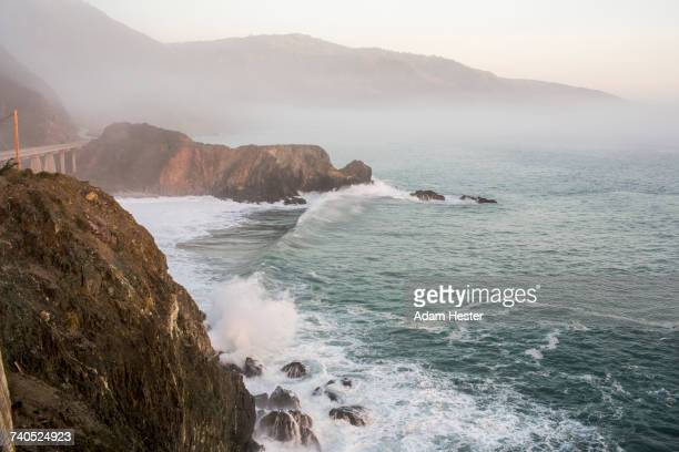 waves splashing on rocks at cliffs - oakland california stock pictures, royalty-free photos & images