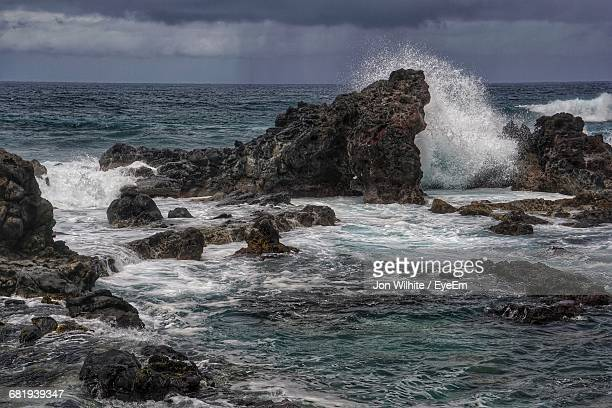 Waves Splashing On Rocks