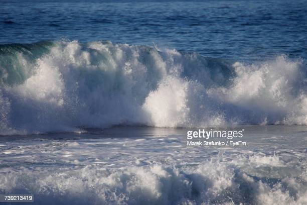 waves splashing on sea against sky - marek stefunko stock pictures, royalty-free photos & images