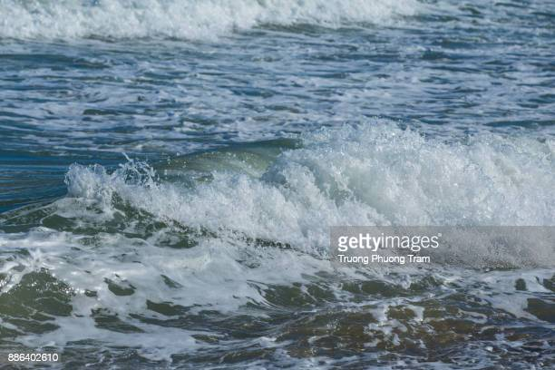 Waves surf the sand at Co Thach beach, Binh Thuan province, Viet Nam.
