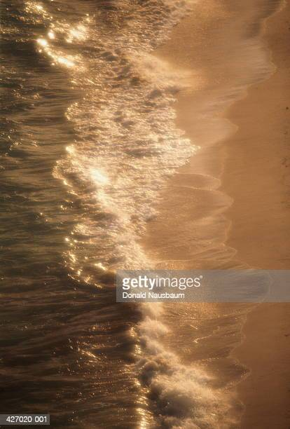 waves washing onto shore, cable beach, nassau, bahamas - cable beach bahamas stock photos and pictures