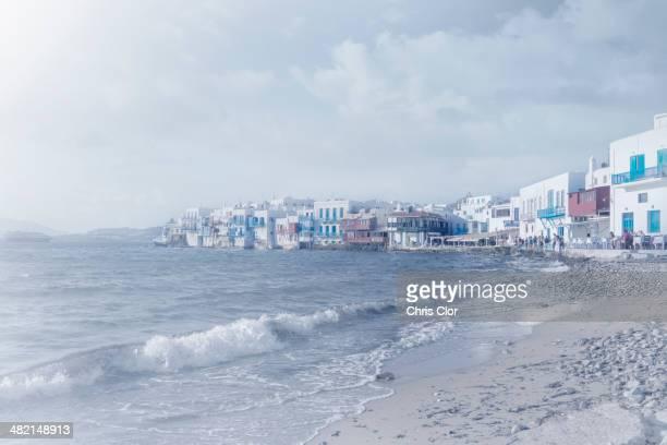 waves washing up on beach, mykonos, greece - ver a hora stockfoto's en -beelden