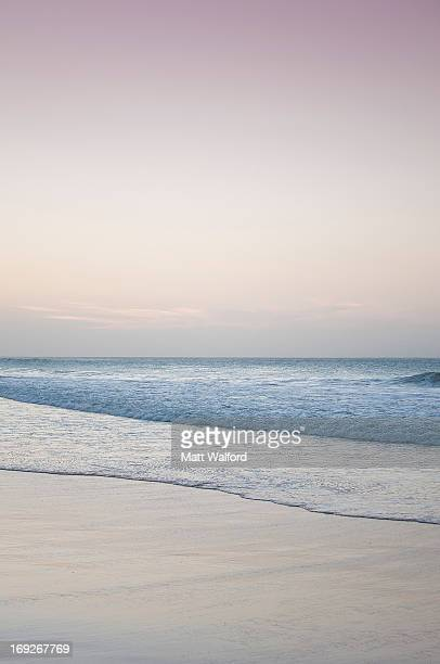 waves washing up on beach - cape verde stock pictures, royalty-free photos & images