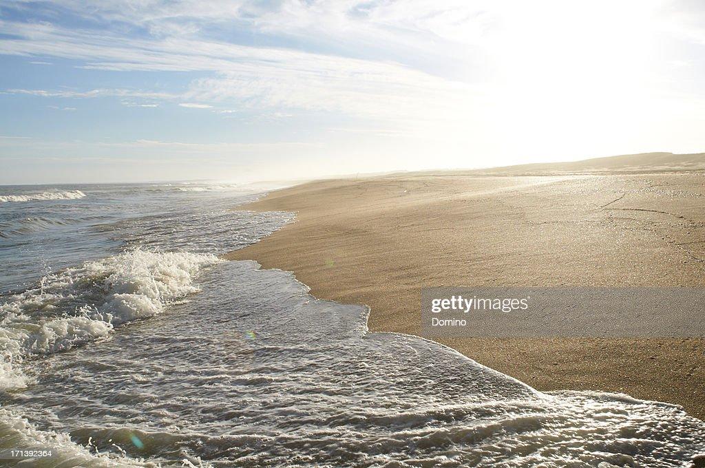 Waves washing up on beach, Uruguay : Stock Photo