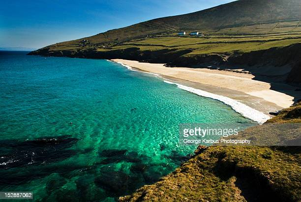 waves washing up on sandy beach - great blasket island stock pictures, royalty-free photos & images