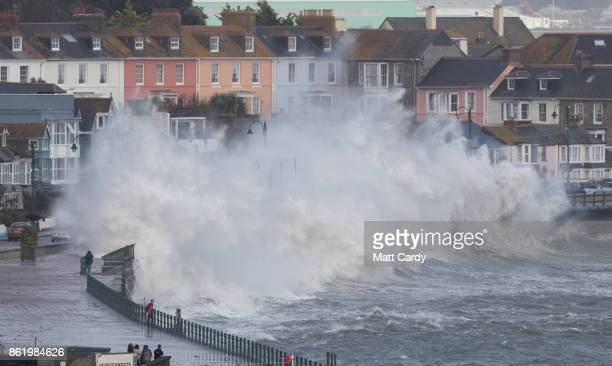 Waves whipped up by Hurricane Ophelia crash over the seafront in Penzance on October 16, 2017 in Cornwall, England. Hurricane Ophelia comes exactly...