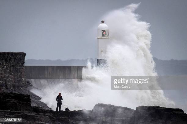 Waves whipped up by Storm Helene hit the seafront on September 18 2018 in Porthcawl Wales As the remnants of Storm Helene passes across the UK the...