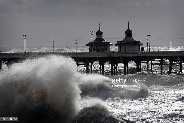 Waves whipped up by the wind lash Blackpool's North Pier on the seafront at Blackpool on March 12 2008 in Blackpool England The British Isles was...
