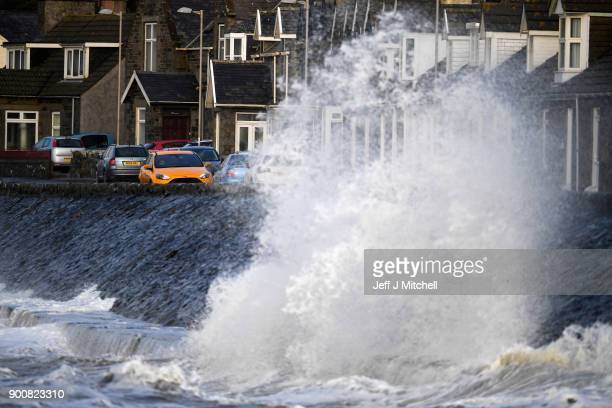 Waves whipped up by the wind of Storm Eleanor lash against the sea wall on January 03 2018 in Port William United KingdomOvernight Storm Eleanor...