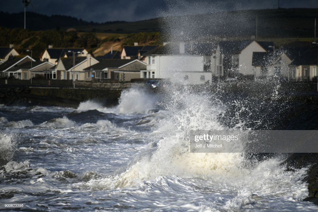Waves whipped up by the wind of Storm Eleanor lash against the sea wall on January 03, 2018 in Port William, United Kingdom.Overnight Storm Eleanor brought 70-100mph gusts and torrential rain to some parts of the UK and Ireland creating floods and cutting electricity supplies in some areas. A yellow warning by the Met Office is still in force.