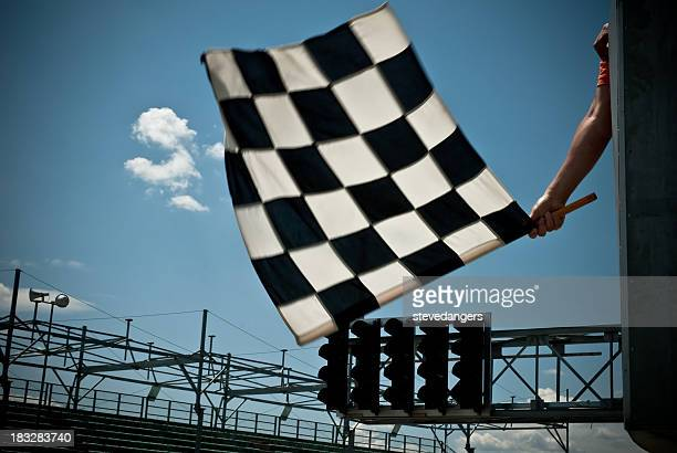 waving checkered flag - finish line stock pictures, royalty-free photos & images
