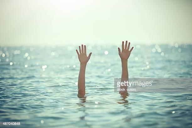 手を振るサポート - sos ストックフォトと画像