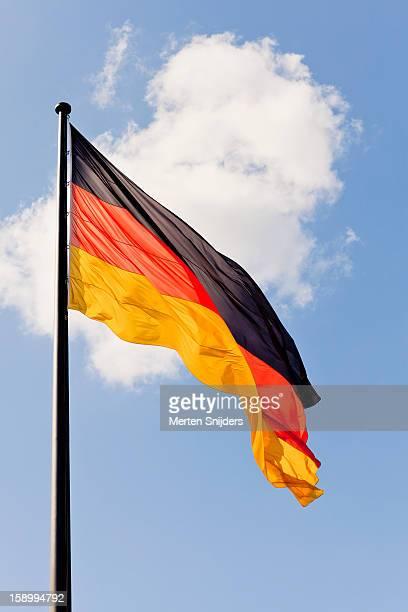 Waving German flag and cloud