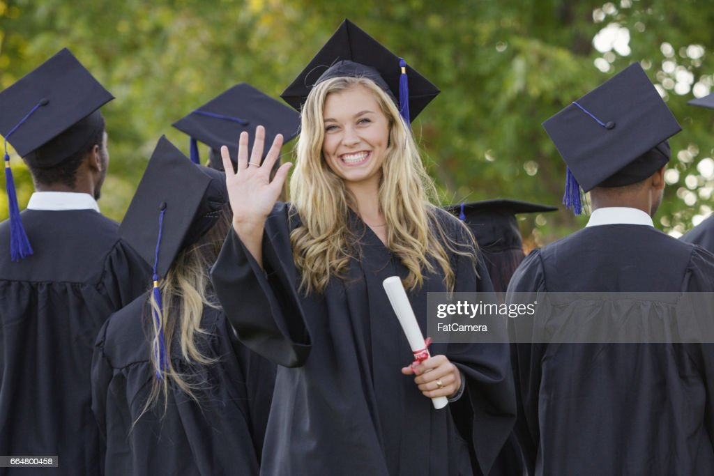 Waving Graduation Student : Stock Photo