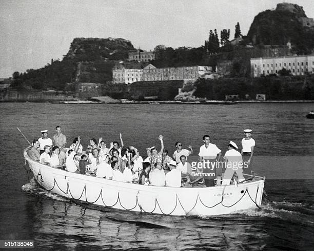Waving like a bunch of delighted tourists a boat load of European royalty heads for the Greek Island of Corfu the first stop on the cruise of kings...