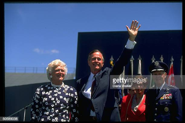 Waving Pres Barbara Bush w Gen Mrs Charles Hamm during Air Force Academy Falcon Stadium graduation fete