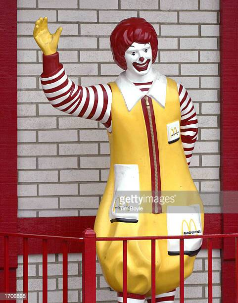 A waving Ronald McDonald figurine is visible outside a McDonald's fastfood restaurant January 2 2003 in Des Plaines Illinois The Oak Brook...