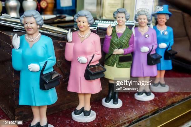 Waving Solar Queen figurines for sale inside a gift shop on Avenida 5 Cinco de Mayo