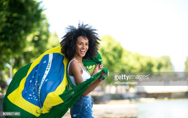 Waving the brazilian flag.