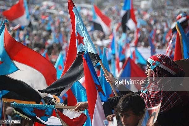 Waving the flag of the former South Yemen thousands rally in Yemen's main southern city of Aden on May 21 demanding renewed independence for the...