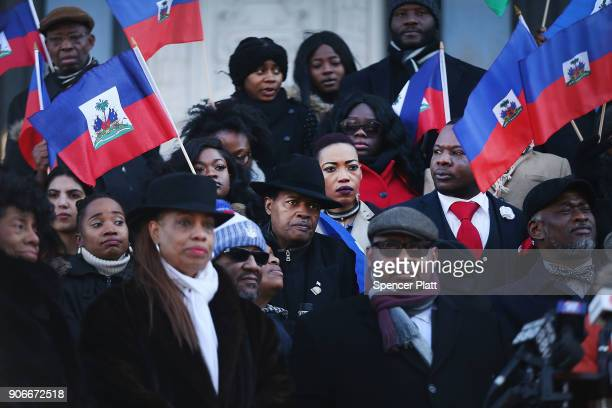 Waving the national flag of Haiti students activists and area politicians attend a unity rally on the steps of City Hall in downtown Newark in...