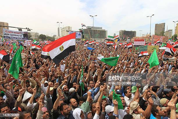 Waving the national flag, thousands of Egypt's Muslim Brotherhood and Salafist movement supporters take part in a demonstration in the capital's...
