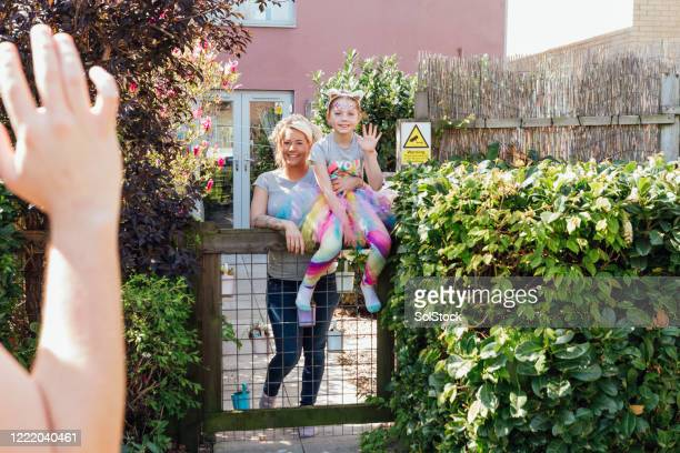 waving to the neighbor - friendship stock pictures, royalty-free photos & images