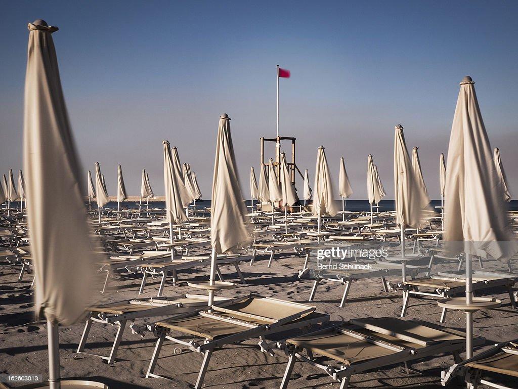 Waving Umbrellas On The Beach : Stock-Foto