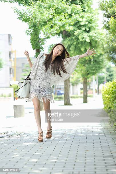 Waving woman while walking