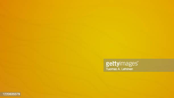 wavy and delicate lines on yellow and orange background. - 掃く ストックフォトと画像