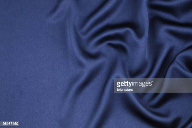 wavy blue satin - satin stock pictures, royalty-free photos & images