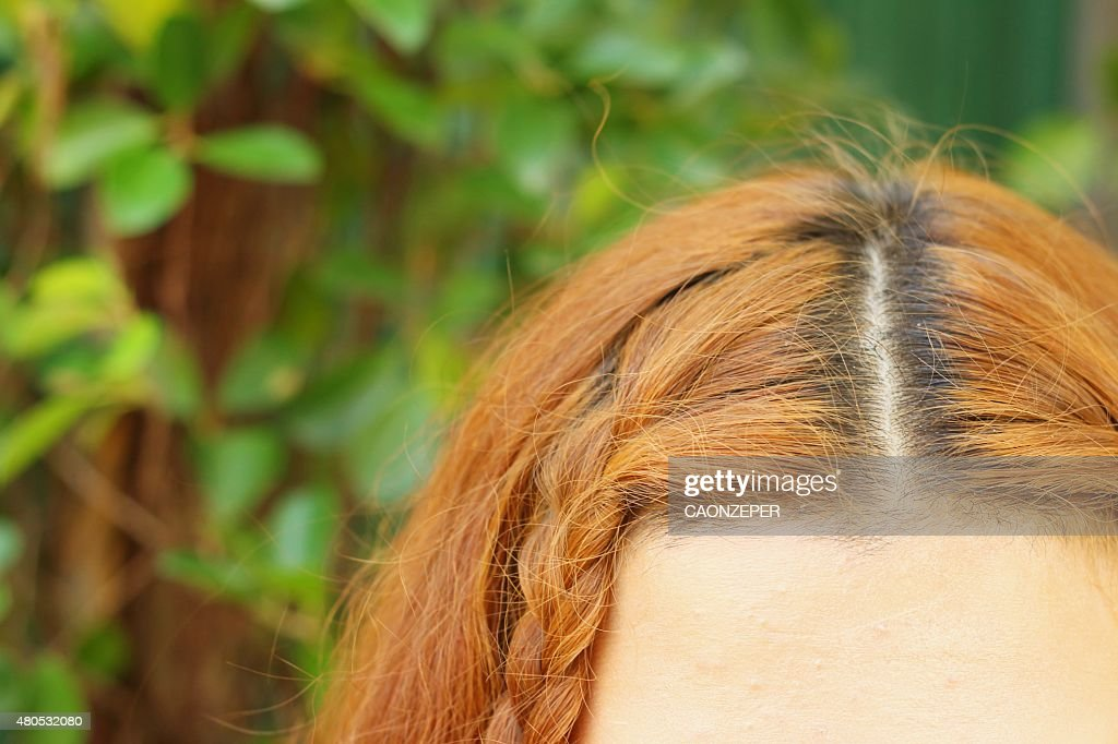 Wavy gold hairs of a beautiful women : Stock Photo