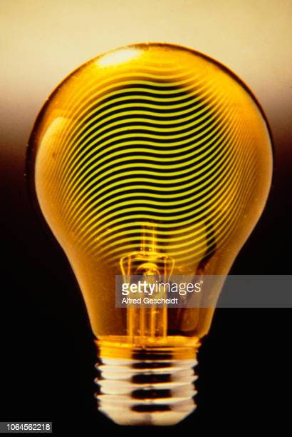 Wavy parallel lines form the filament of a light bulb 1983